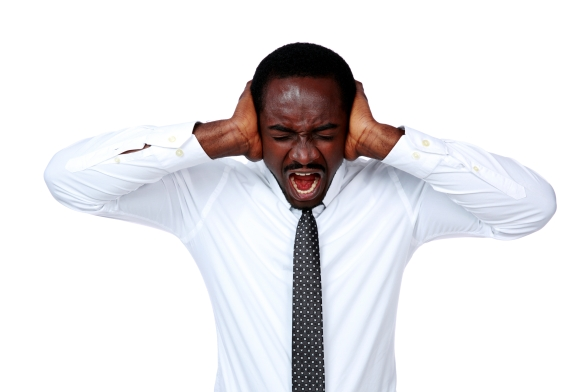 Portrait of african businessman shouting and closing ear by his hands on white background